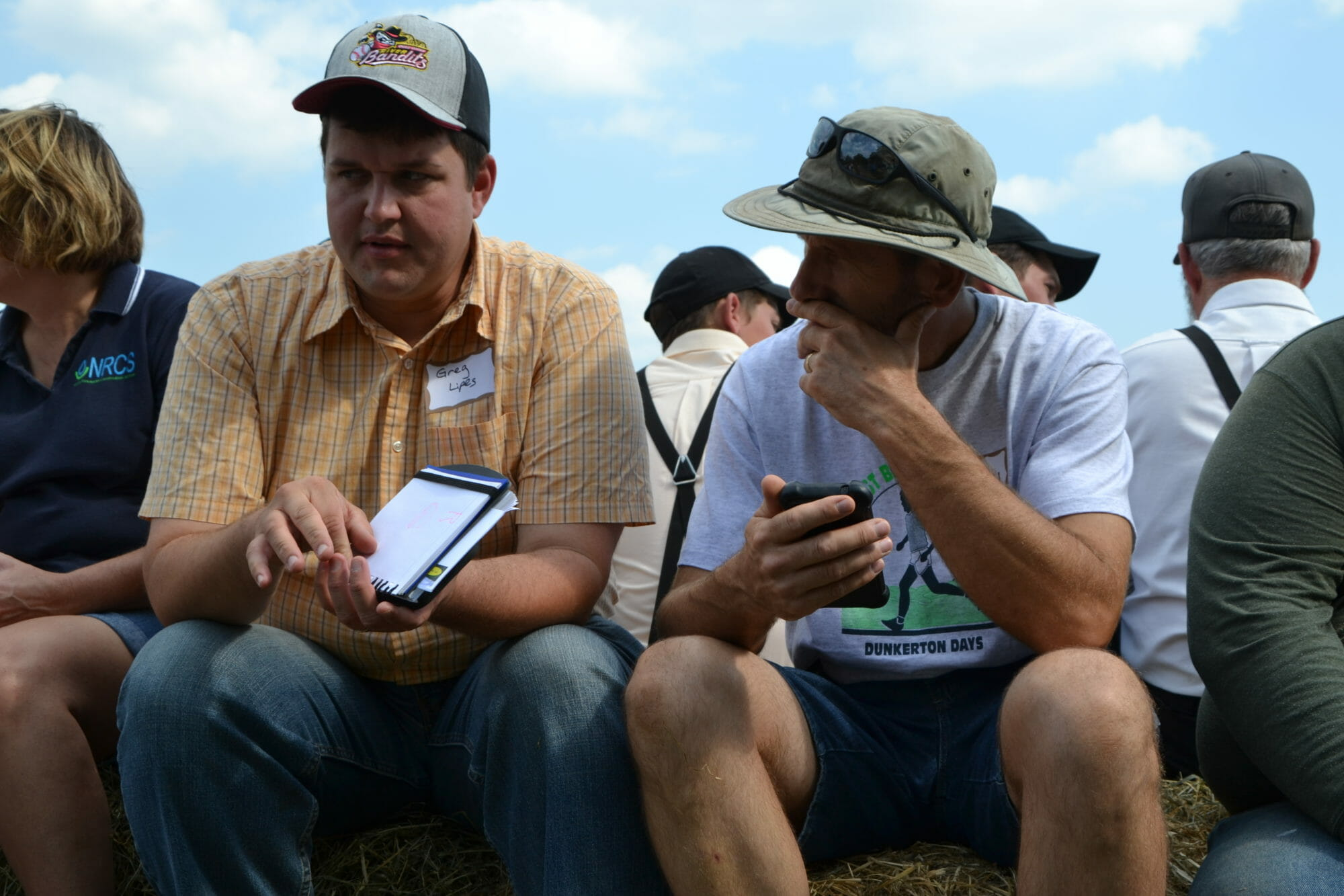From left: Greg Lipes and Earl Canfield listen to the discussion.