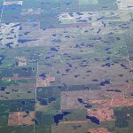 Aerial view of Iowa farm fields peppered with prairie potholes (photo from Iowa Learning Farms blog)